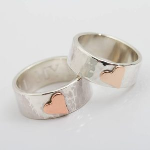 Beaten Silver ring with copper heart detail.